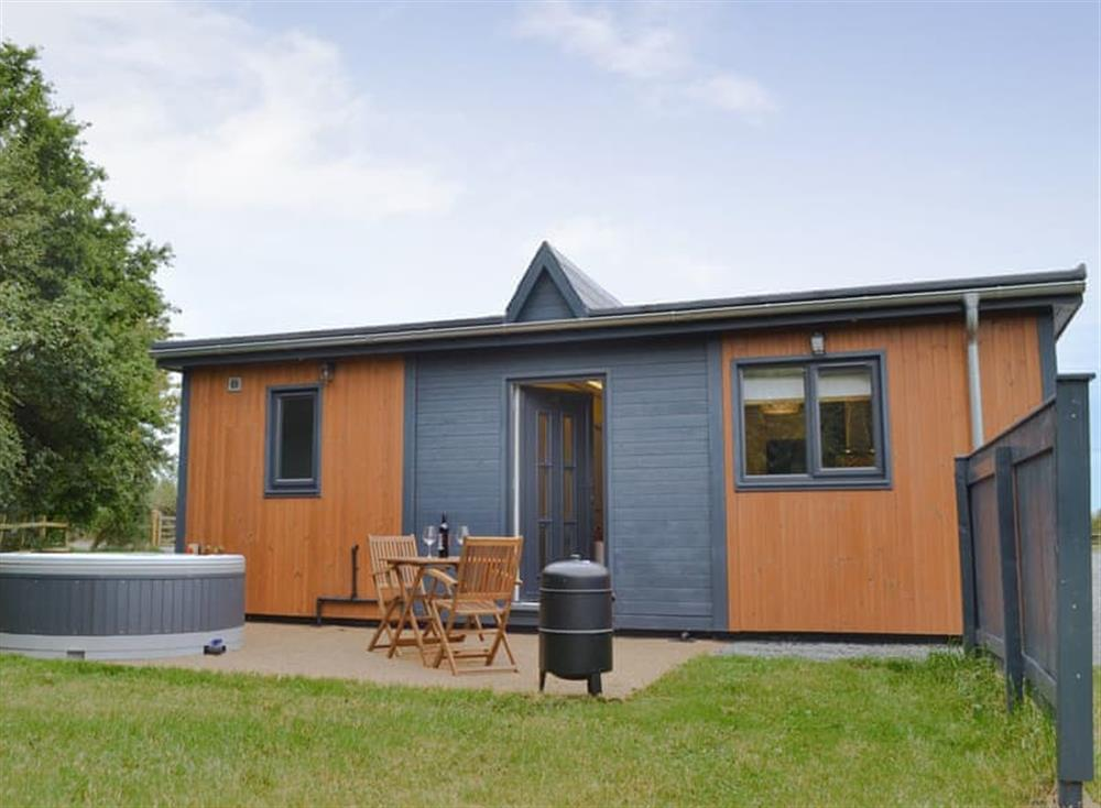 Single-storey holiday home with hot tub at The Ashram,