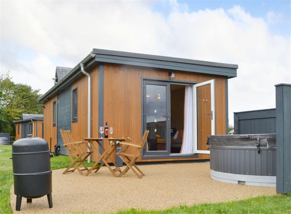 Attractive holiday home hot tub and with shared garden area at The Lotus,