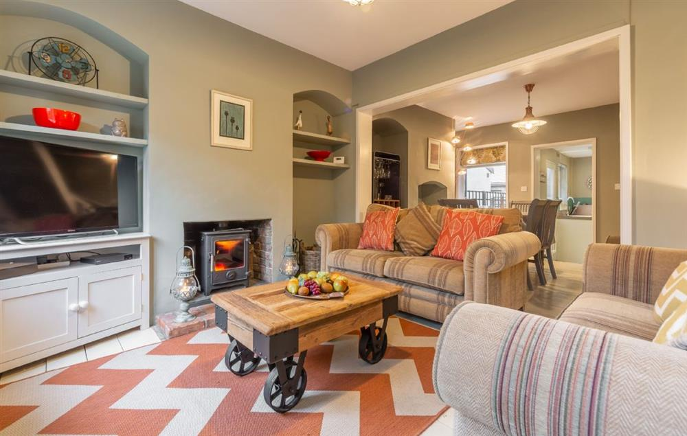 Ground floor: Cosy sitting room which has two large sofas and a wood burning stove, large flat screen television (photo 2)