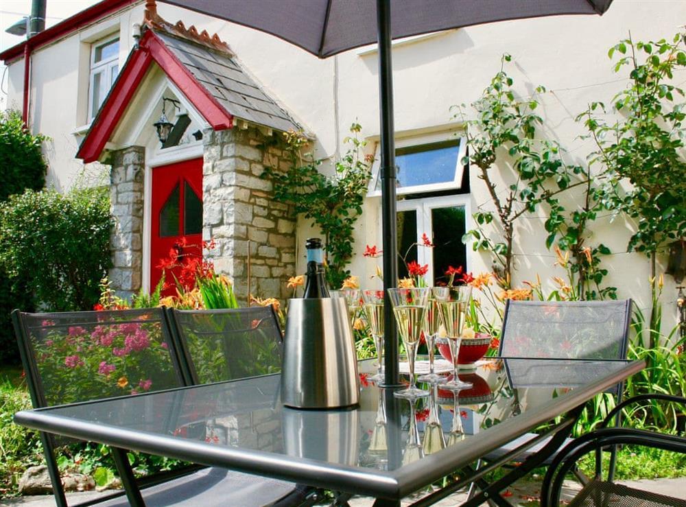 Outdoor furniture within the garden at Nythfa in Llantwit Major, Glamorgan, South Glamorgan
