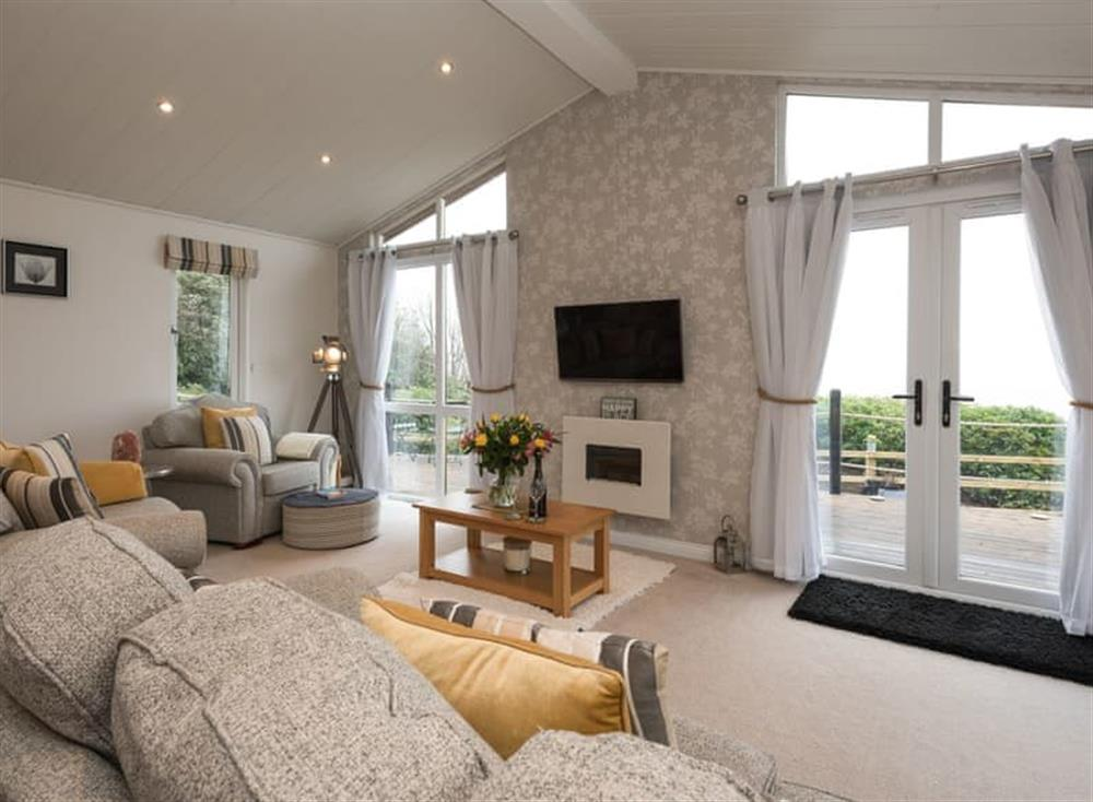 Open plan living space at Ocean Retreat Lodge in Corton, near Lowestoft, Suffolk