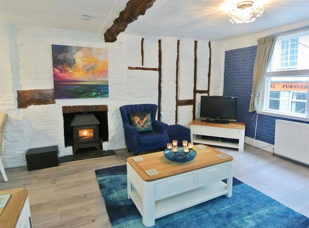 Cosy living area with wood burner (photo 2) at Ocello in Ocello, Devon