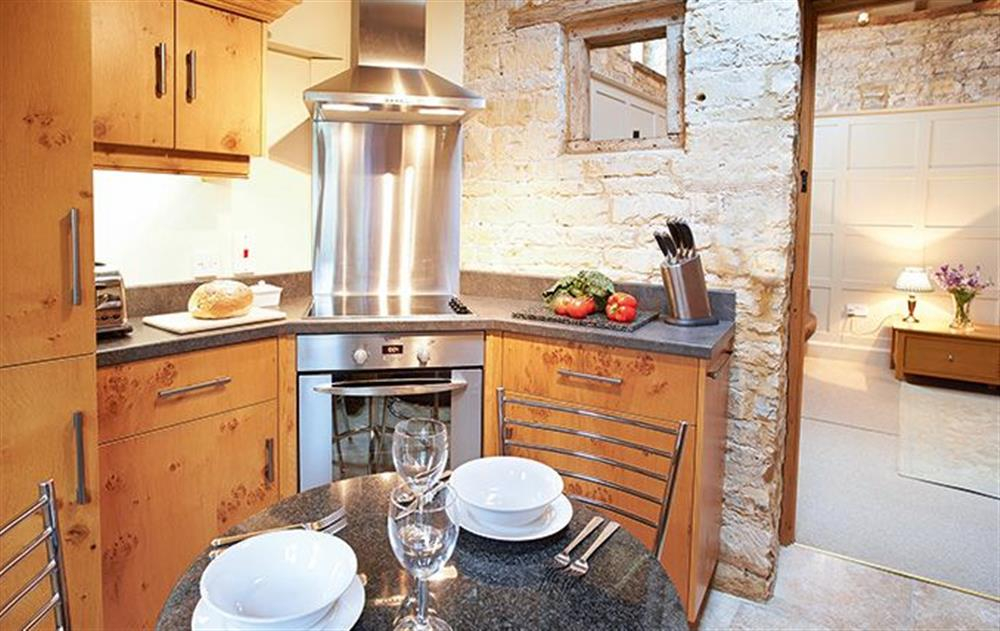 Ground floor:  Kitchen with dining table at Old Bothy, Halford