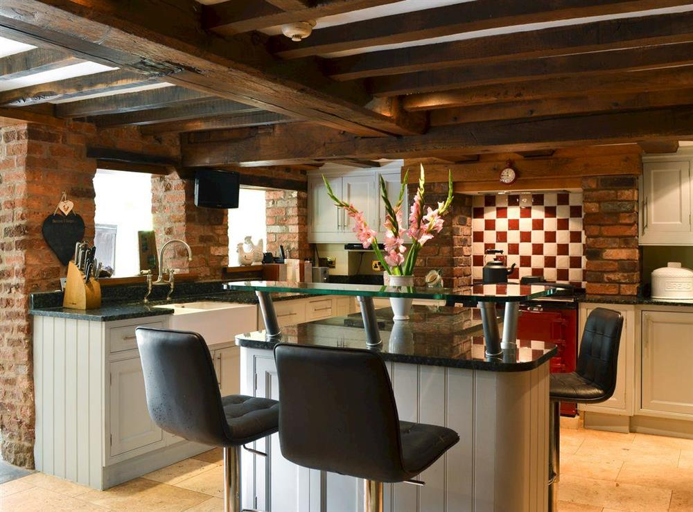 Well-equipped kitchen with oil Aga at Old Castle Mill in Malpas, Cheshire