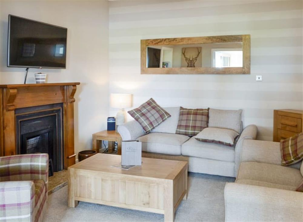 Welcoming living area at Old Loans Cottage in Loans, near Troon, Ayrshire