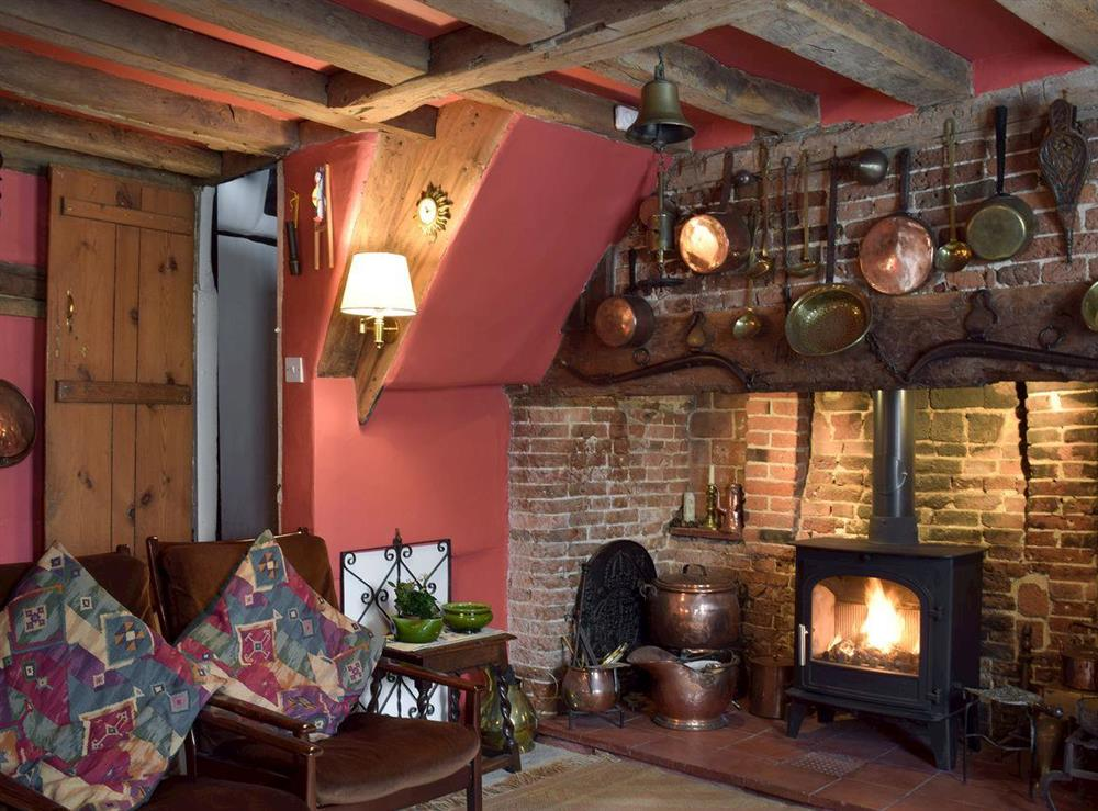 Cosy living room with exposed beams & wood burner (photo 2) at Old Maltsters Arms Cottage in Pulham St Mary, near Diss, Norfolk
