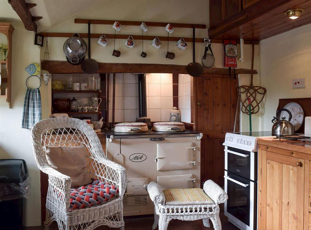 Kitchen with Aga at Old Maltsters Arms Cottage in Pulham St Mary, near Diss, Norfolk