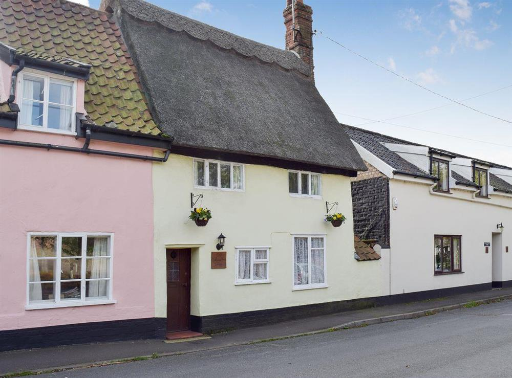 Semi-detached, traditionally styled, thatched property at Old Maltsters Arms Cottage in Pulham St Mary, near Diss, Norfolk