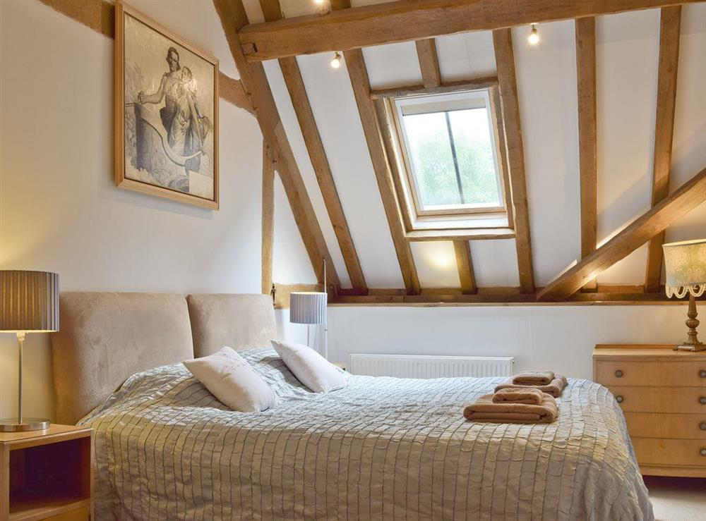 Characterful double bedroom at Falstaff Cottage,