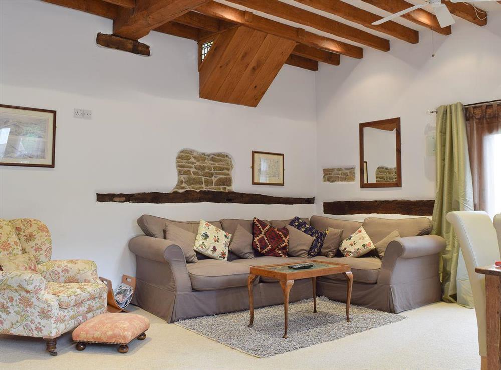 Comfy lounge area at Falstaff Cottage,
