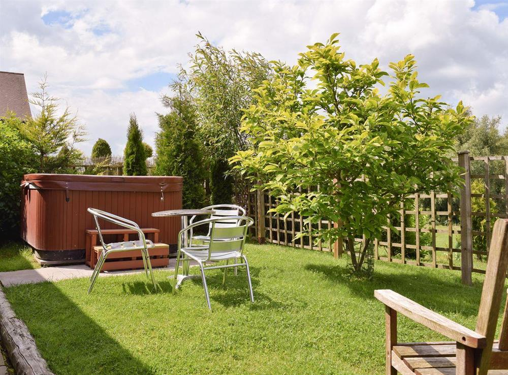 Luxurious hot tub in enclosed garden at Falstaff Cottage,