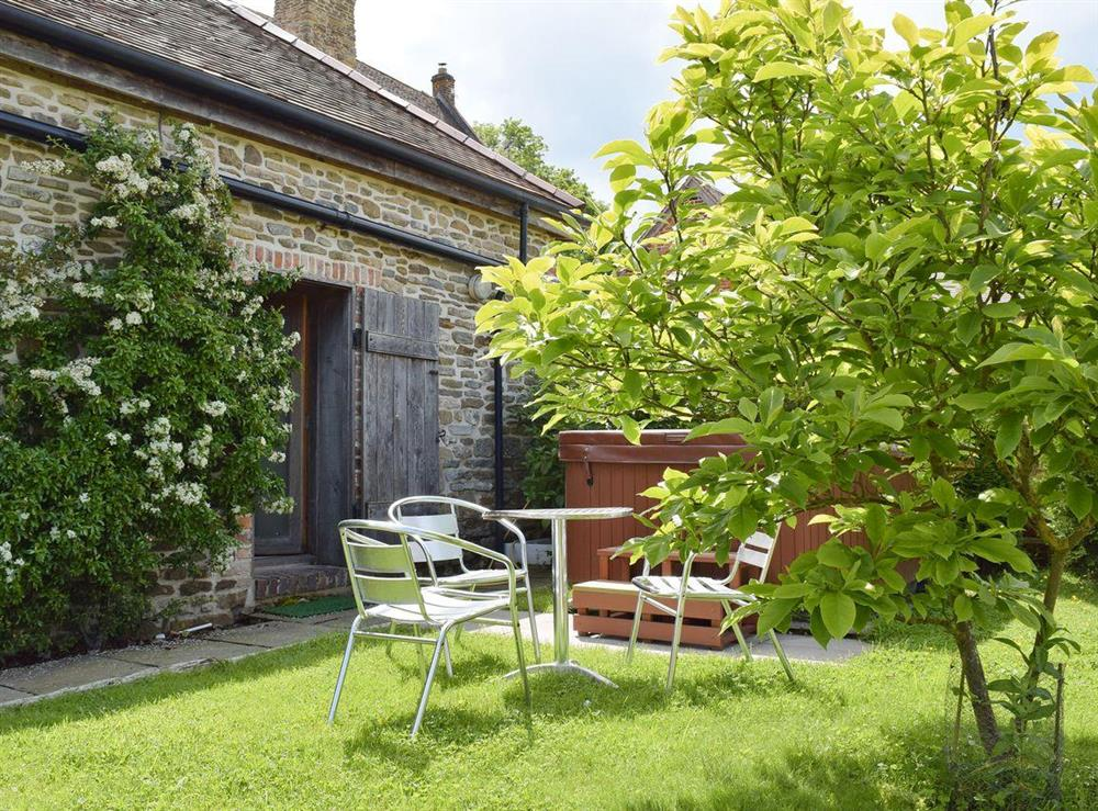 Sitting out area at rear at Falstaff Cottage,