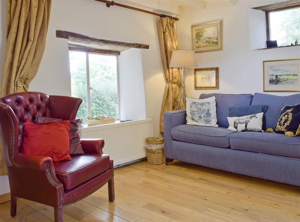 Comfy seating in living room at Lovers Cottage,