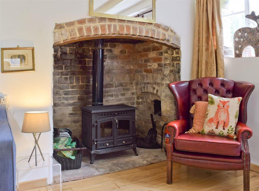 Heritage fireplace with wood-burner at Lovers Cottage,