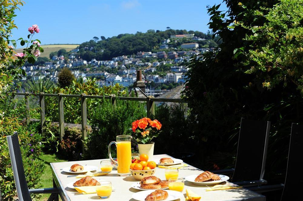 A lovely patio area to the rear of the property with beautiful views at Onedin House in 11 Crowthers Hill, Dartmouth
