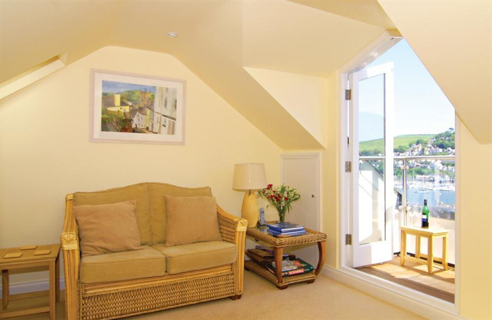 Bright loft sitting room with balcony at Onedin House in 11 Crowthers Hill, Dartmouth
