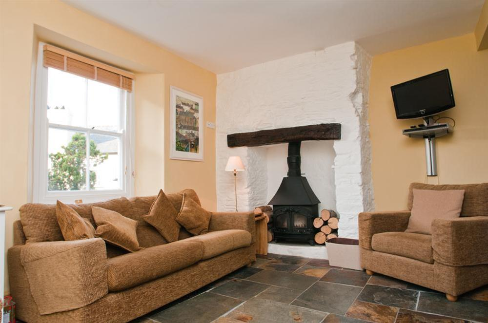 Comfortable lounge area with stone flooring and under-floor heating at Onedin House in 11 Crowthers Hill, Dartmouth