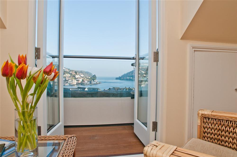 Dormer from loft leading to balcony with unspoilt views of the River Dart and out to sea at Onedin House in 11 Crowthers Hill, Dartmouth