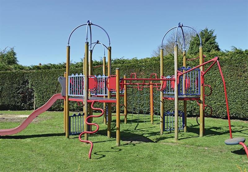 Children's play area at Orchard Farm Caravan Park in Witham Bank, Chapel Hill