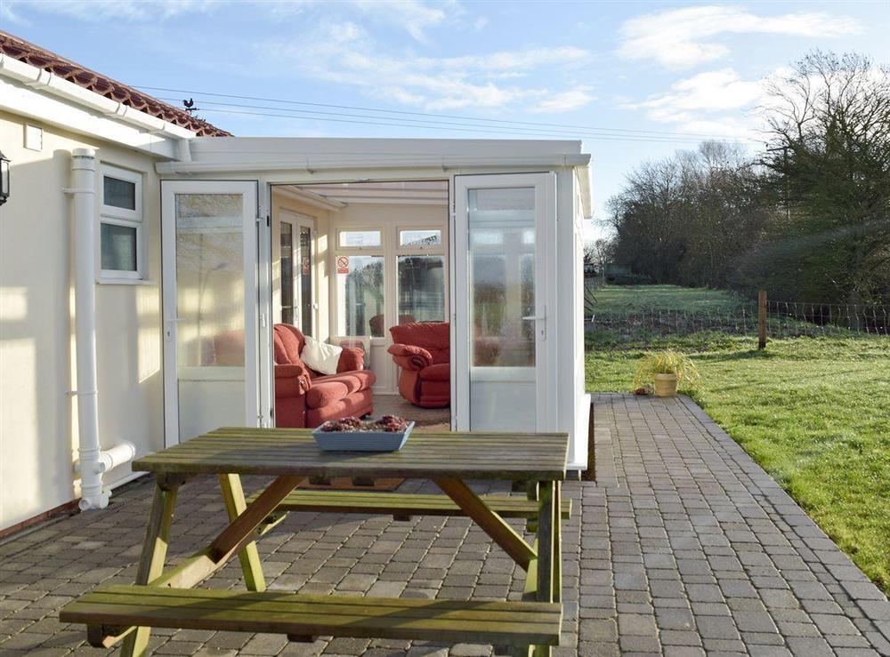 Conservatory & sitting out area at Orchard Farm Cottage in Barnby, near Beccles, Suffolk