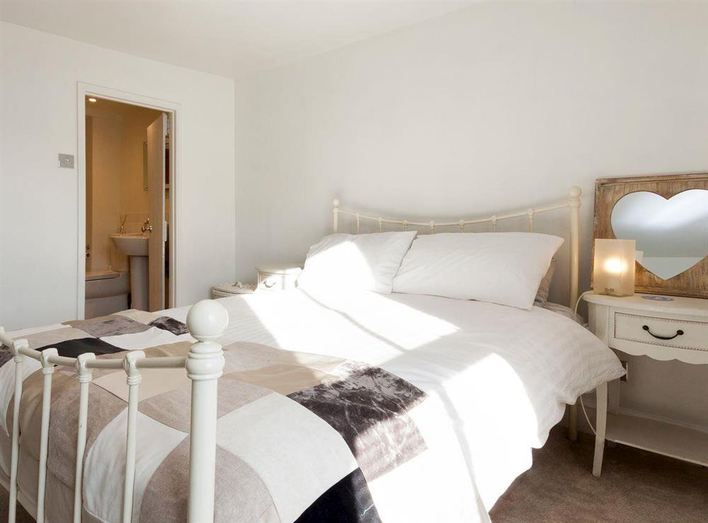 Comfortable double bedroom with en-suite (photo 2) at Otter Cottage in Dartmouth, Devon