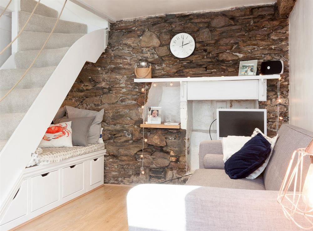 Cosy living area at Otter Cottage in Dartmouth, Devon
