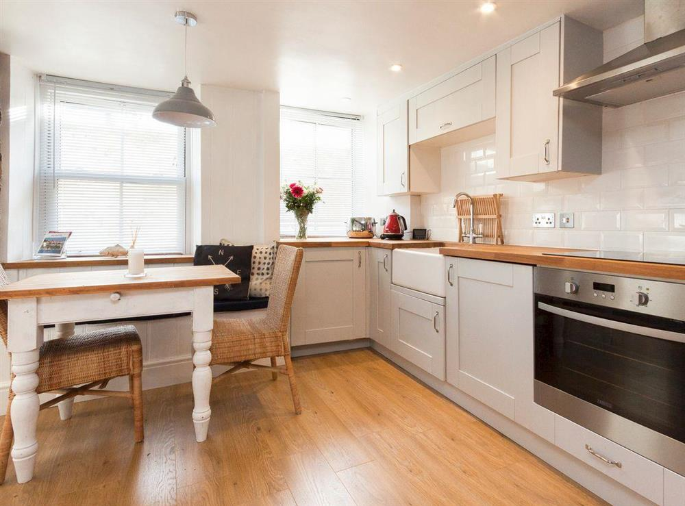 Fully fitted kitchen and dining area at Otter Cottage in Dartmouth, Devon