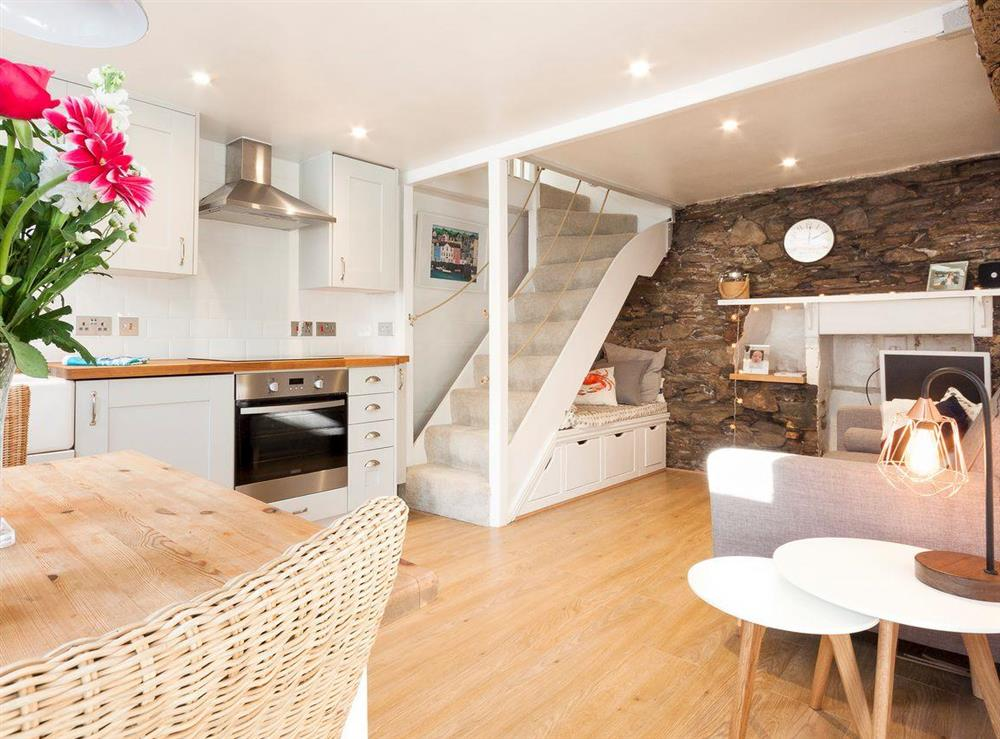 Open plan living space at Otter Cottage in Dartmouth, Devon
