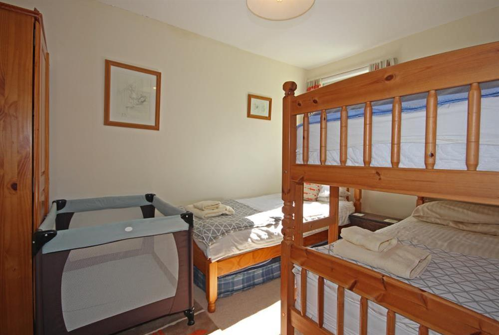 Bedroom with bunk beds, single and travel cot at Out To Sea in 120 Above Town, Dartmouth