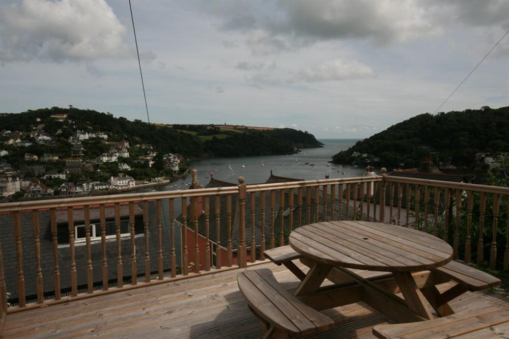 Raised decking area to the rear of the cottage at Out To Sea in 120 Above Town, Dartmouth