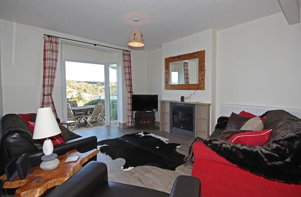 Very comfortable sitting room with French doors to terrace at Out To Sea in 120 Above Town, Dartmouth