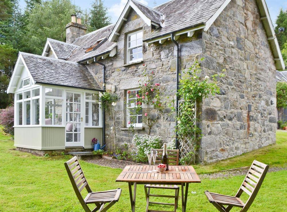 Exterior with garden & seating area at Over Blairish Cottage in Keltneyburn, near Aberfeldy, Perthshire