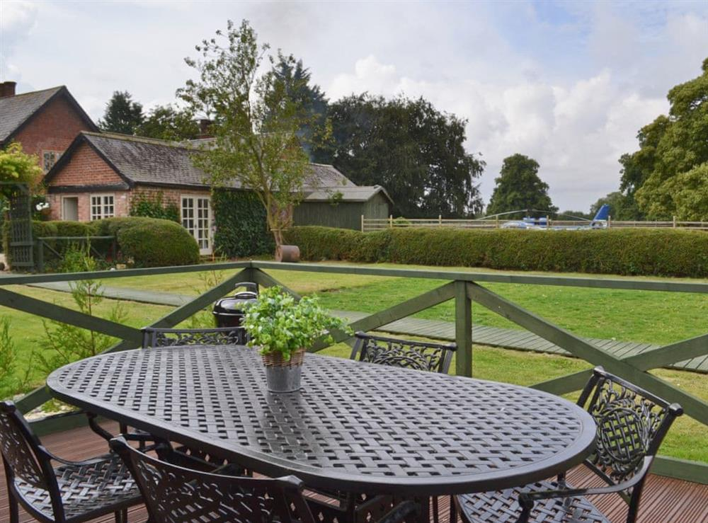 Large lawned garden with decking, patio and garden furniture at Pampita Lodge in Beverley, North Humberside