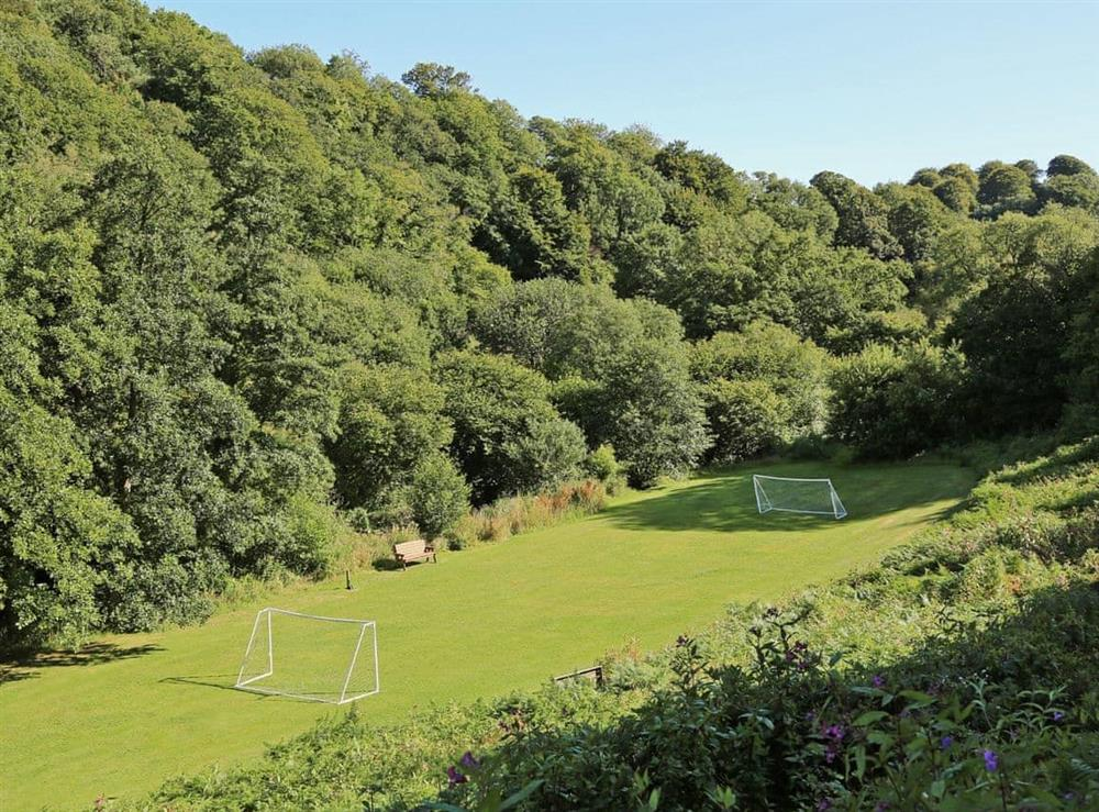 Football field at Papermaker's Cottage in Bow Creek, Nr Totnes, South Devon., Great Britain