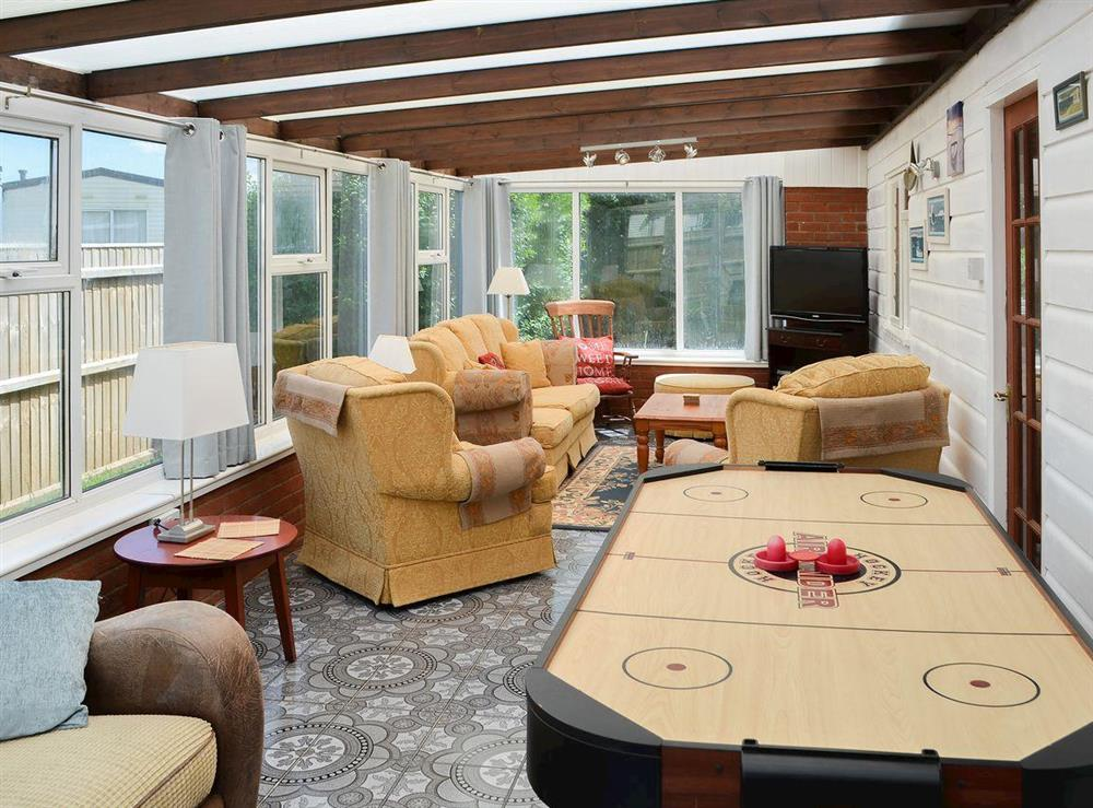 Delightful living room with air hockey table at Park End in Walcott, near Stalham, Norfolk