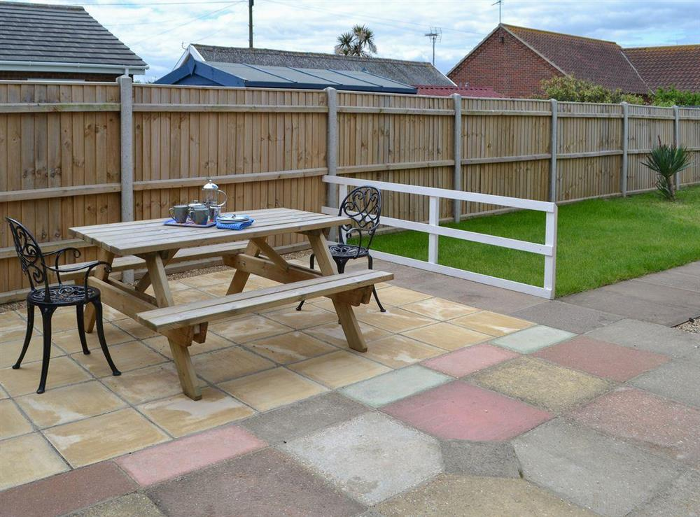 Enjoy an alfresco meal on the patio at Park End in Walcott, near Stalham, Norfolk