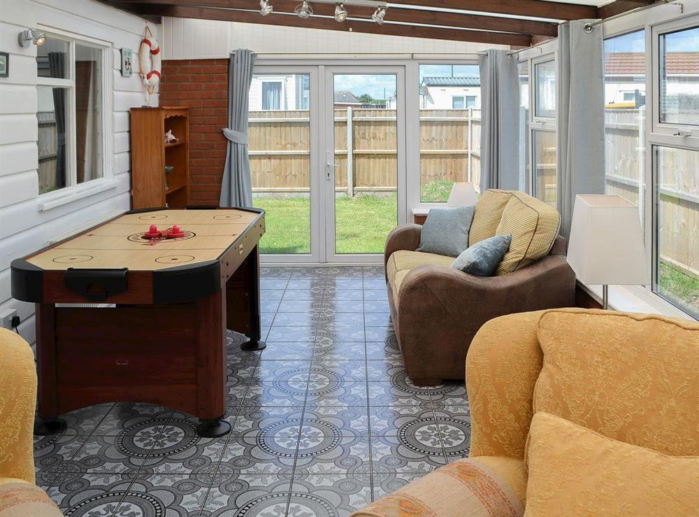 Lovely living room with French doors to garden at Park End in Walcott, near Stalham, Norfolk