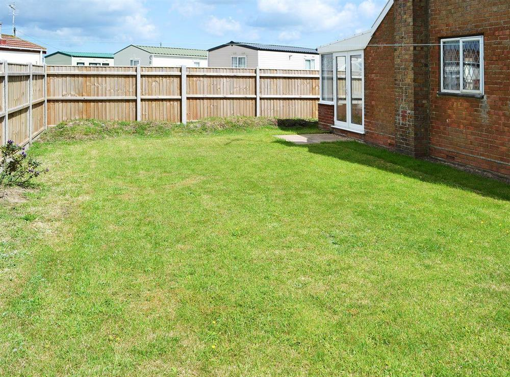 Set in an enclosed lawned garden at Park End in Walcott, near Stalham, Norfolk