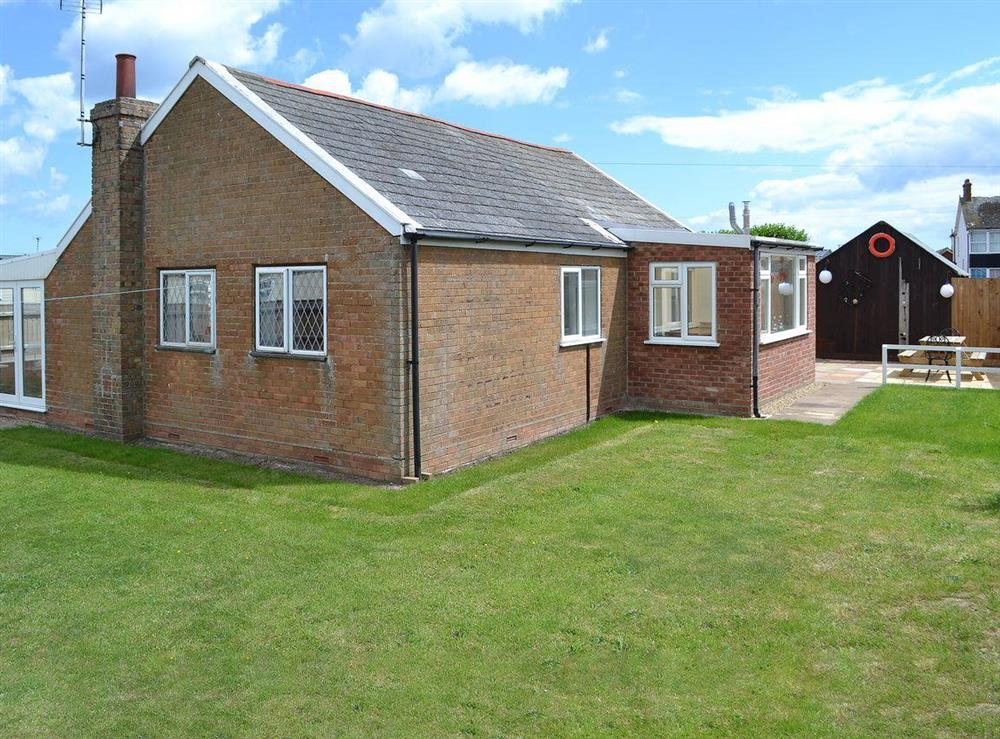 Spacious detached seaside bungalow at Park End in Walcott, near Stalham, Norfolk