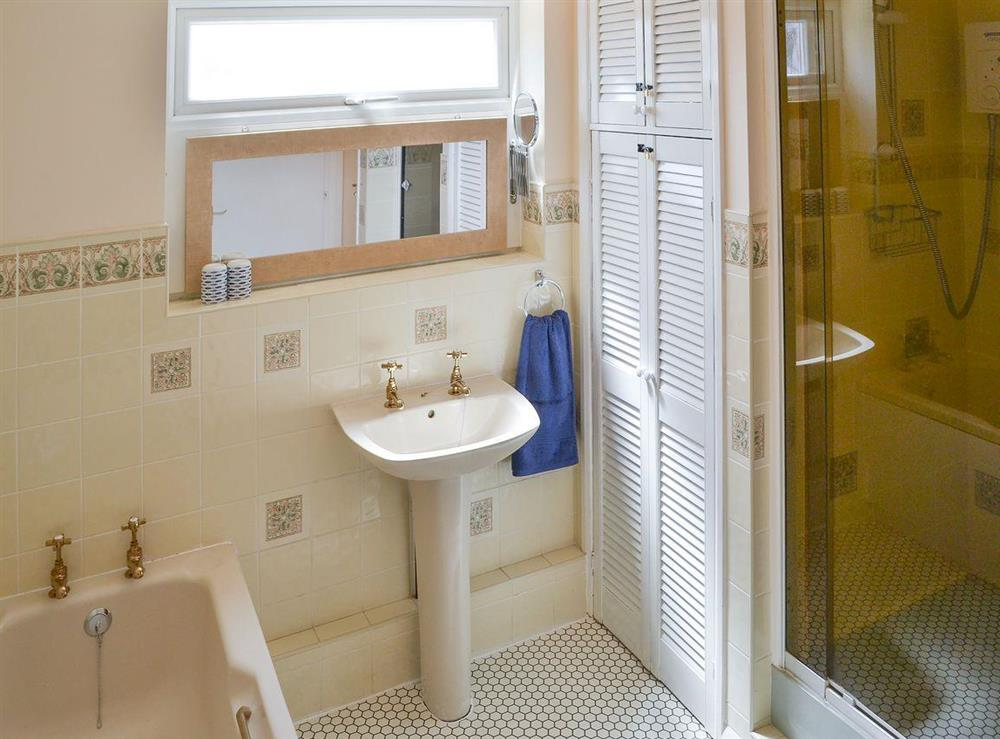Tiled bathroom with shower cubicle at Park End in Walcott, near Stalham, Norfolk