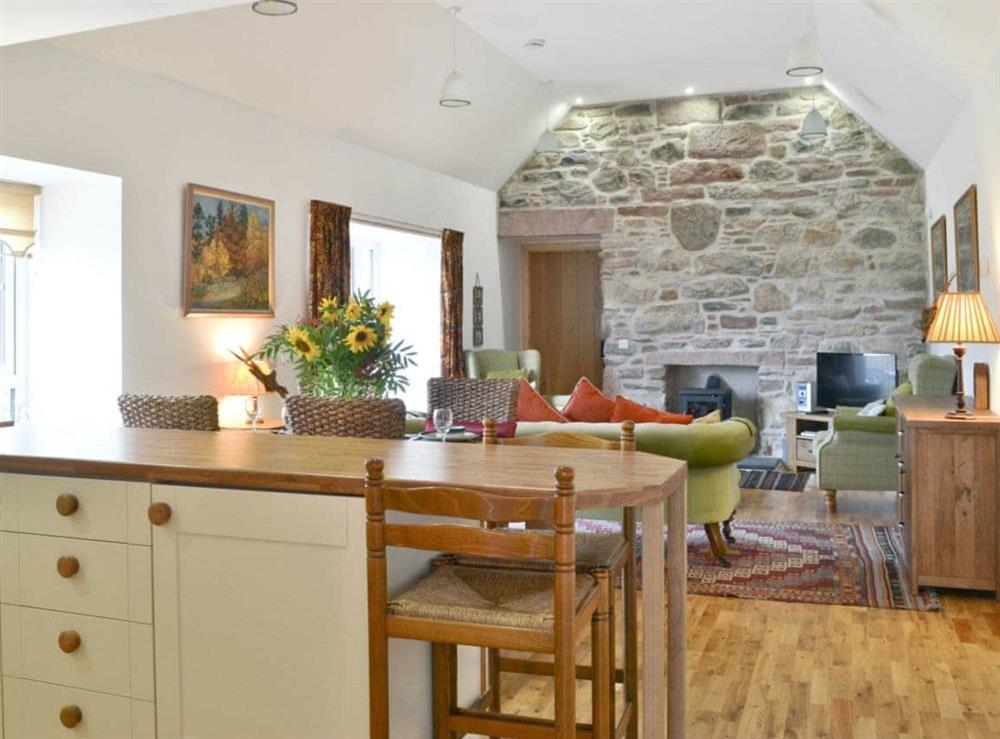 Open plan living/dining room/kitchen at Paterson Cottage in Muir of Ord, Ross-Shire