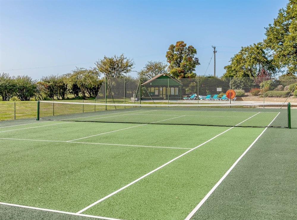 Tennis court at Pattiswick Hall in Pattiswick, near Coggeshall, Essex