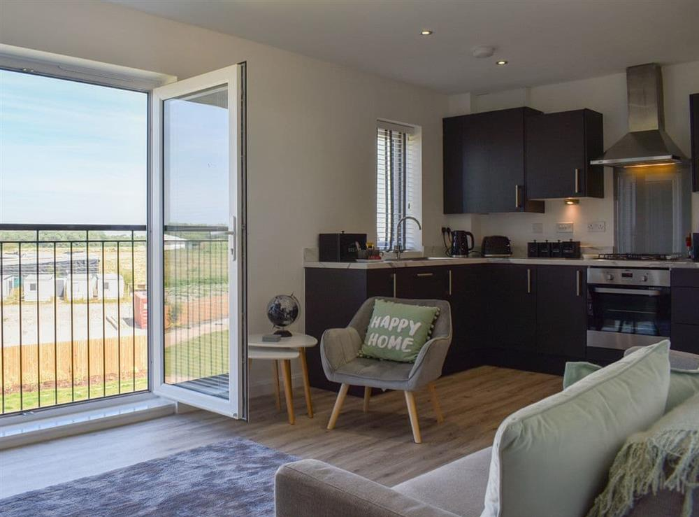 Open plan living space at Pavilion Gardens Apartment in Southport, Merseyside