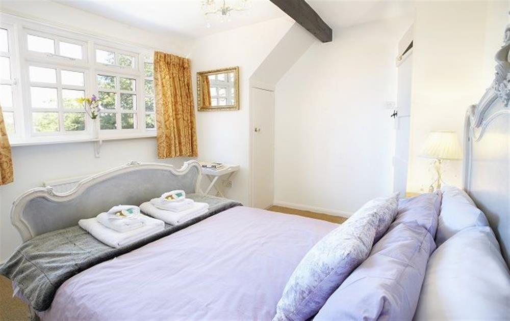 First floor:  Double bedroom with 4'6 bed at Peak Hill Cottage, Theberton