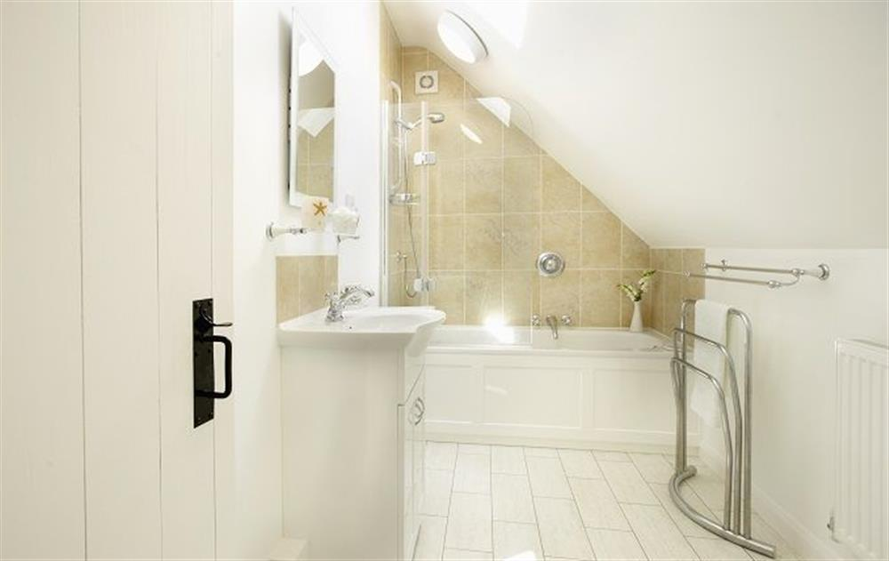 First floor:  Family bathroom with shower over the bath and wc at Peak Hill Cottage, Theberton