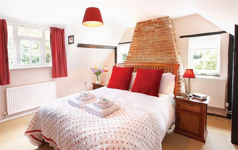 First floor:  King size bedroom with 5' bed at Peak Hill Cottage, Theberton