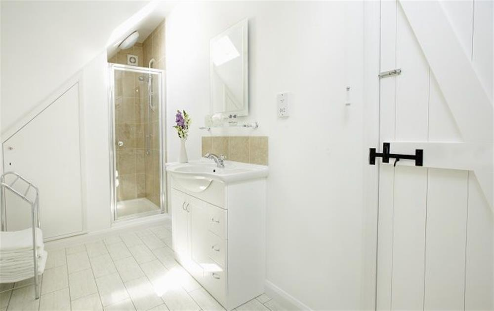 First floor:  Shower room with wc at Peak Hill Cottage, Theberton