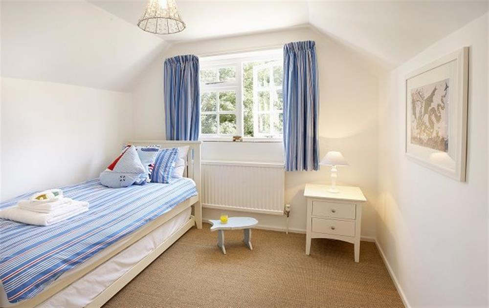 First floor:  Single bedroom with 3' bed and truckle bed for an additional child at Peak Hill Cottage, Theberton