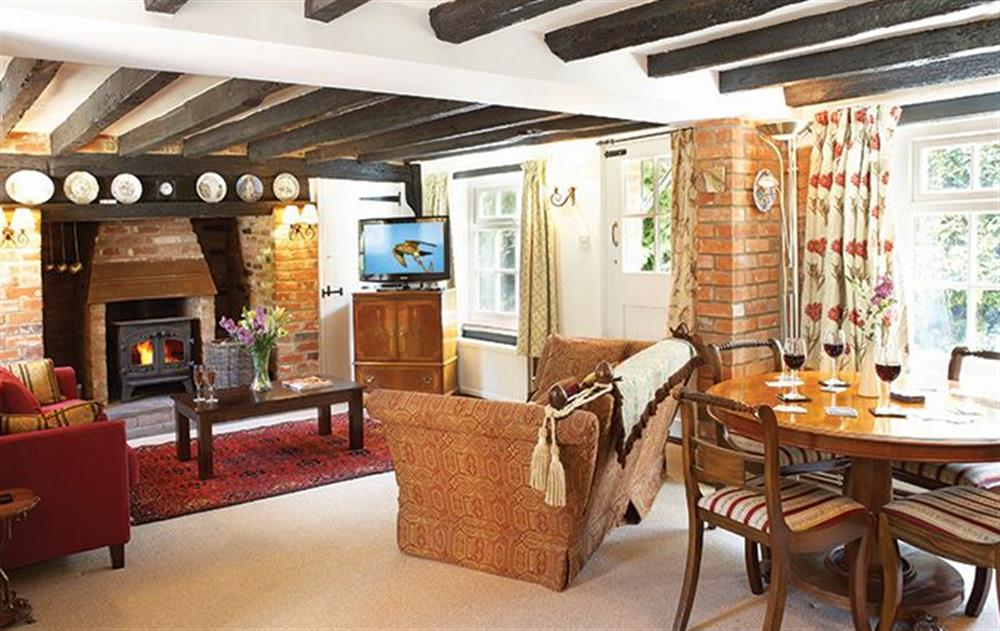 Ground floor:  Sitting room with wood burning stove  at Peak Hill Cottage, Theberton