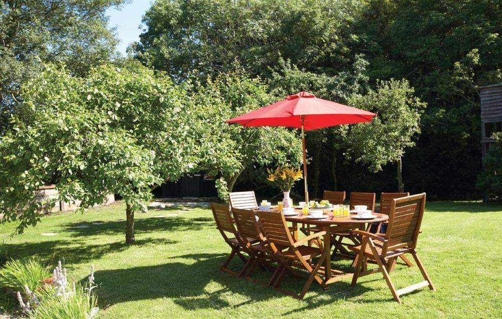 Large, lawned gardens at Peak Hill Cottage, Theberton